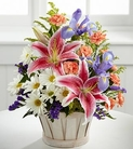 Stargazer lilies, iris, daisies, and carnations