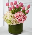 Pink tulips, pink roses, and hydrangea