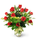 A Dozen Red Roses with Tropical Greens