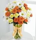 Orange spray roses, yellow mini carnations and white daisies